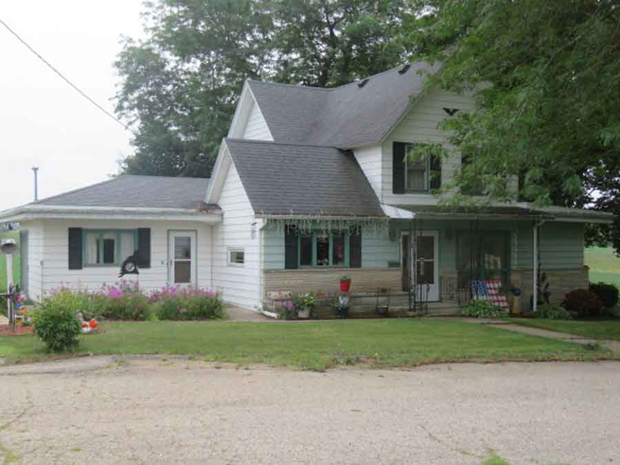 Country Home Setting at edge of town with 1.74 acres